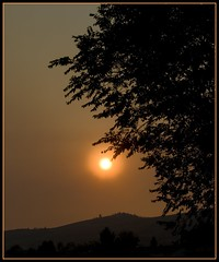 smoky sunset (tiffa130) Tags: sunset sky orange cloud sun mountain canada tree silhouette fire haze bc terrace britishcolumbia smoke creative july free commons creativecommons stockphotos smokey forestfire smoky hazy vernon 2009 flickrstock freestockphotos july2009 terracemtfire photobytiffa