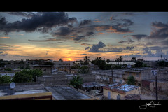 A Gathering Storm 2 (jsnowy2768) Tags: sunset storm clouds neighborhood westafrica senegal saintlouis hdr quartier coucherdusoleil lacorniche ndar senegalriver lefleuvedusenegal