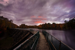 Bays Mountain (Andy Stacy) Tags: longexposure autumn sunset red orange lake fall water yellow canon fence concrete purple dam tennessee dramatic naturallight wideangle chainlink walkway 5d f22 f4 baysmountain mkii markii 1740l kingsport