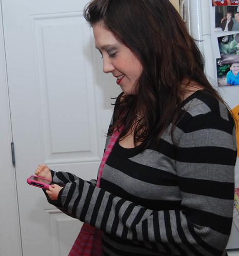 Baby hands on her iPhone