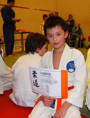 Promotion II #2 (tokek belanda (very busy)) Tags: boy orange judo holland netherlands sport kids tim belt band nederland timothy timo oranje gelderland jongen budo kiryoku