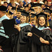 Doctoral graduate students celebrate their degrees.