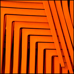 Intrecci (Isco72) Tags: orange abstract detail lines square chairs panasonic repetition minimalism minimalismo astratto sedie arancione quadrato dettaglio cubism greatphoto linee linescurves ripetizione photographia fineartphotos overtheexcellence fz18 dmcfz18 bestminimalshot awardflickrbest isco72 phvalue francescopallante daarklands