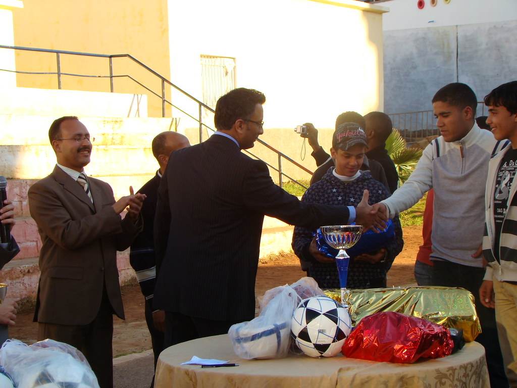 Shaaz Mehboob presents sports equipment to young people
