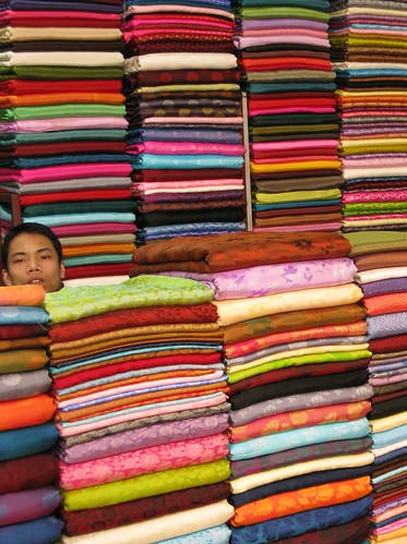 Trapped in the cloth shop at Dong Xuan Market - Hanoi, Vietnam