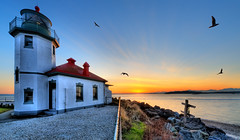 Lighthouse Sunset Birds In Flight (Surrealize) Tags: ocean seattle roof light sunset red sea sky coastguard cloud sun lighthouse bird beach water point evening washington nikon rocks sundown dusk seagull alki pugetsound hdr olympicmountains 14mm d700 surrealize