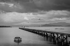 Pier (Bernardo Möller) Tags: sea brazil bw water brasil clouds boats pier boat mar fisherman cloudy florianópolis stormy paisagem santacatarina florianpolis