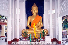TH06010 (Henry Westheim Photography) Tags: sculpture orange art statue architecture thailand religious temple gold golden ancient worship sitting peace buddha buddhist prayer religion peaceful siamese buddhism icon sash divine holy thai sacred eastern siam seated isaan nakhonphanom revered