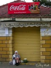 Moroccan (cmphotoroll) Tags: yellow muslim islam coke morocco oldbuilding tangier tangiers muslimwoman burka 5photosaday arabicwriting worldwidewandering