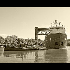 Chugging along the Cuyahoga River (Don Iannone) Tags: water sepia river nikon flickr clevelandohio tugboat tug shipping cuyahogariver downtowncleveland reflectiononwater portofcleveland lakefreighter doniannone waterphotography alcoway doniannonephotography nikond2xcamera