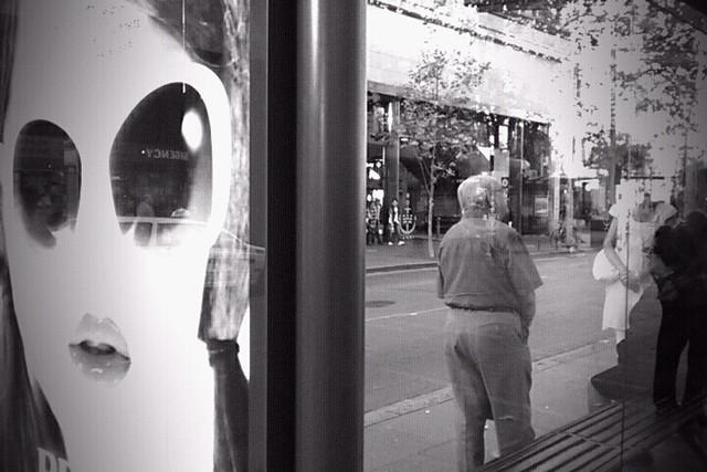 people bw bus sunglasses mobile stand alien circularquay busstop advertisement keep prada praiseandcurseofthecity wander keep2 keep3 keep4 keep5 walk6 flickrdroid rasazukauskaite torangatomanly