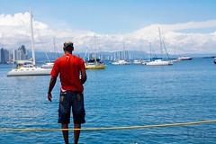 (tatadbb) Tags: blue red sea sky man azul canon boat mar rojo barco ship pasto grama cielo developers conference fedora panama tap pesca hombre usuarios conferencia users bote fudcon desarrolladores