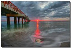 RED! Sunrise (Fraggle Red) Tags: ocean red sun beach water clouds sunrise dawn sand surf florida shell hollywood northbeach jpeg atlanticocean hdr conch onfire conchshell canonefs1022mmf3545usm daniabeach blueribbonwinner supershot 3exp mywinners abigfave daniabeachpier platinumphoto anawesomeshot aplusphoto browardco dphdr rubyphotographer conchconnection rachellesrcohibafragglered