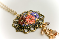 festival of happiness pendant (Chili Crab) Tags: flowers blue brown green leaves yellow gold one chili crystal handmade ooak peach violet crab jewelry kind fimo lilac clay etsy brass 2009 mothersday pendant filigree polymer swarovsky