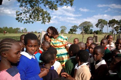 On the first day when Kakenya came back to her school, all the students ran out to give her hugs.