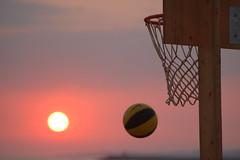 foto sport canestro tramonto
