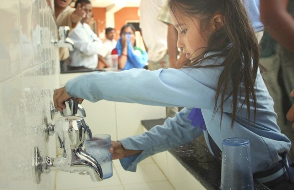 Students lined up to refill their glasses again and again at the shiny new clean drinking water station