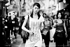 Eye contact; Takeshita Street, Harajuku, Tokyo (Alfie | Japanorama) Tags: street woman cute girl monochrome beautiful fashion japan walking asian japanese tokyo nikon eyecontact asia pretty moody young harajuku grainy busted crowds crowded d300 takeshitastreet takeshitadori blacandwhite streetphotograhy slightlypissedoff nikkor80200mmf28ed tokyostreetphotography