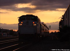 Pushin Into the Twilight (El Roco Photography) Tags: california railroad cloud santafe night clouds canon losangeles diesel amtrak locomotive orangecounty metrolink fullerton bnsf glint railroads passengertrain emd atsf burlingtonnorthernsantafe fullertoncalifornia f59phi alltrains amtrakcalifornia bnsfrailroad burlingtonnorthernsantaferailroad movingtrains elrocophotography