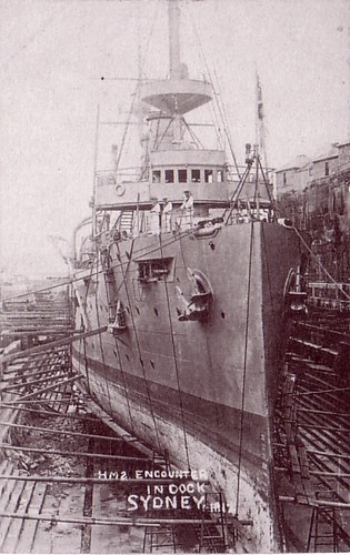 Early 1900s: HMS Encounter, later HMAS, in the Fitzroy Graving Dock, Sydney - Photo Cockatoo Island Dockyard [postcard].