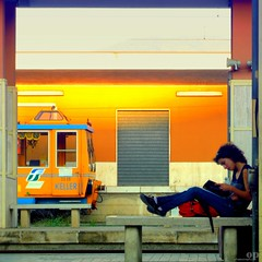 Waiting (Osvaldo_Zoom) Tags: italy girl station train canon bench reading student rail commuter calabria railstation trenitalia g7