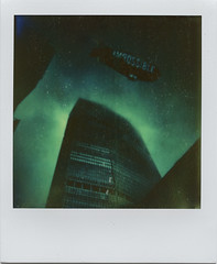 Impossible skies (Rhiannon Adam) Tags: city polaroid highrise blimp slr680 integralfilm impossibleproject 680beta