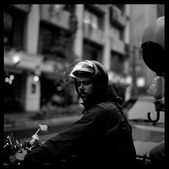 Thoughtful Moment (gullevek) Tags: blackandwhite 6x6 bike japan umbrella geotagged tokyo bokeh helmet    ilford    iso125 ilfordfp4125 epsongtx900 bronicaectl zebrio zenzanonmc80mmf24 geo:lat=35671964 geo:lon=139761675