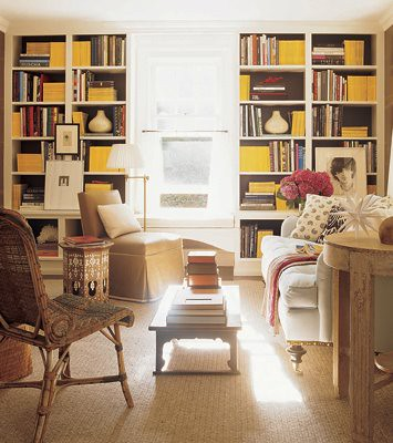 Warm neutrals + yellow accents: Library by Jeffrey Bilhuber, featured in Elle Decor