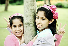"DEMA & HAYA (""Anwaar) Tags: uk pink girls tree cute wales kids canon peace faces sister united small cardiff kingdom daisy lovely kuwaiti arabs dema 28200mm 400d hyona goldstaraward anwaar"
