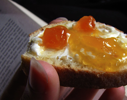 slice of baguette with cream cheese and apricot preserves