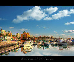 Kuwait Marina [HDR] (alvin lamucho ) Tags: ocean city blue trees sea coffee yellow clouds marina buildings reflections boats malls palm starbucks waters kuwait yachts fahaheel speedboats canon450d rebelxsi alvinlamucho