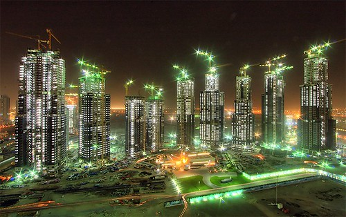 a cluster of new towers rises in Dubai (by: Mohamed Somji, creative commons license)