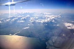 My First glimpse of Japan - Tagajo/Sendai (caribb) Tags: sunset sea reflection japan clouds island tokyo earthquake asia tsunami  nippon  sendai   edo overview windowseat aircanada  viewfromaplane  777333er lejapon cfivm