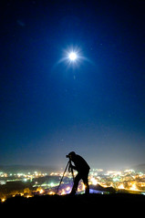 Under the Moon (Sergiu Bacioiu) Tags: camera city houses moon male men guy slr art silhouette night digital work dark lens fun person photography lights photo focus bravo flickr photographer technology shot image tripod hill snapshot picture posing lifestyle photographic hobby professional equipment human photograph shutter activity outline dslr shape job photographing occupation objective blaj mywinners abigfave saariysqualitypictures