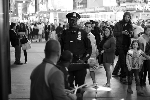 Officer Inquires Whether the Drummers have a Permit