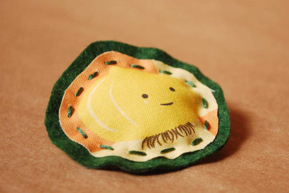 onion brooch
