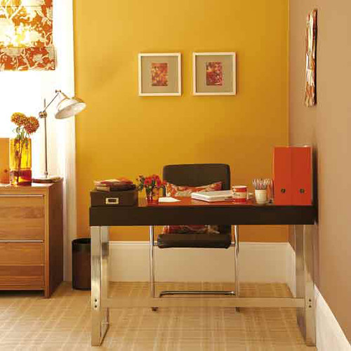 Bright, modern office: Orange paint + chocolate-brown accents