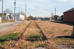 old industrial buildings and brownfields line the abandoned rail corridor (courtesy of AIA)