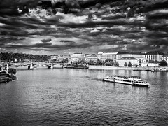 Storm clouds gather over the Vltava (pj_warlock) Tags: blackandwhite bw white black river four boat holidays prague events praha olympus micro third vltava olympos omd em5 micro43 microfourthirds