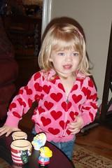 Catie in her red heart sweatshirt
