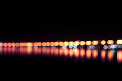 (S) Tags: sea orange black reflection cars water yellow night lights traffic coldplay bokeh corniche fixyou