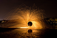 playing with fire (duane.schoon) Tags: light lightpainting wool night reflections florida sparklers explore sarasota frontpage lapp ouchthathurts lightjunkies duanesphotos photocreativity neoncathode lightareperformancephotography