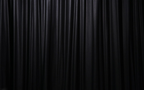 Black curtains, it's like someone is daring me open them. I wonder ...