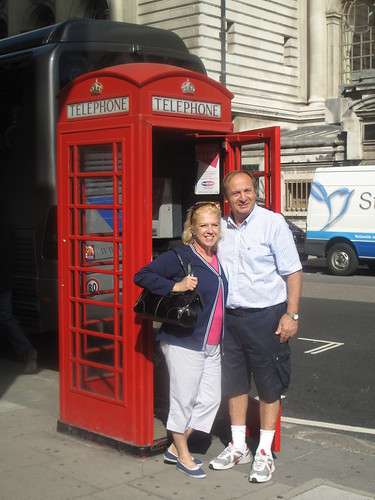 Spanish tourists posing by a London phone box