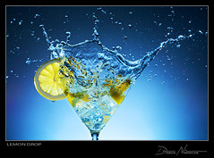Lemon Drop (dave nitsche) Tags: blue water glass yellow still lemon martini splash conceptual nitsche