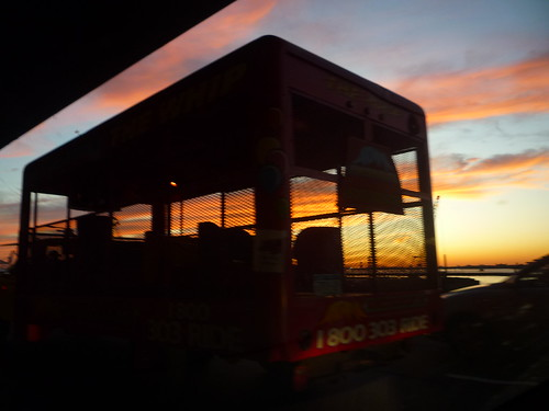 epic sunset seen through carnie ride
