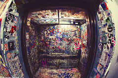 Fisheyed Elevator! (dj murdok photos) Tags: california urban vintage graffiti losangeles sony cluster stickers sigma wideangle tags retro fisheye hollywood recordstore alpha amoeba f28 10mm
