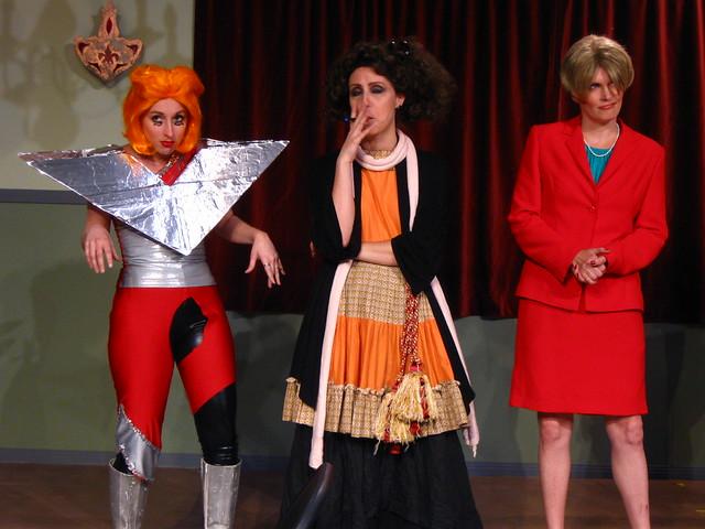Panelists Lady Gaga (Vanessa Perkins), Helena Bonham-Carter (Mandi Moss) and Suze Orman (Erin Matthews).