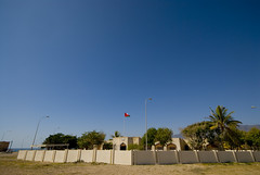 Oman Mirbat420 (jjay69) Tags: fence town village gulf flag muslim islam guard middleeast security arabic walls oman complex hamlet gcc islamic arabi lamposts sultanateofoman dhofar mirbat dhofarregion muslimcountry battleofmirbat mirbatpolicestation marbat