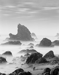 Scylla (allanga_69) Tags: ocean longexposure sea blackandwhite usa mist cold film beach northerncalifornia monster rock mediumformat dark landscape sand unitedstates dusk gothic wave pacificocean mysterious sonomacounty brooding shellbeach mythical